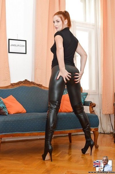 Fully clothed hot redhead Eva bares sexy ass close up wearing high heel boots