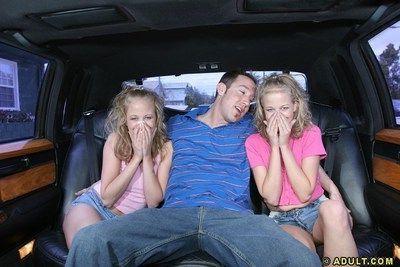 Lusty teenies give a proper sandwich blowjob on the back seat