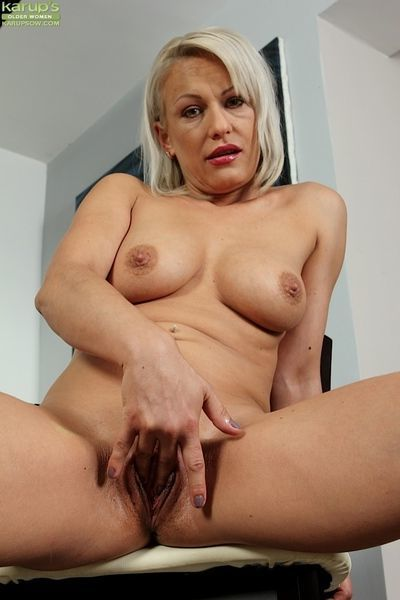 Experienced blonde broad revealing big tits before masturbation relief