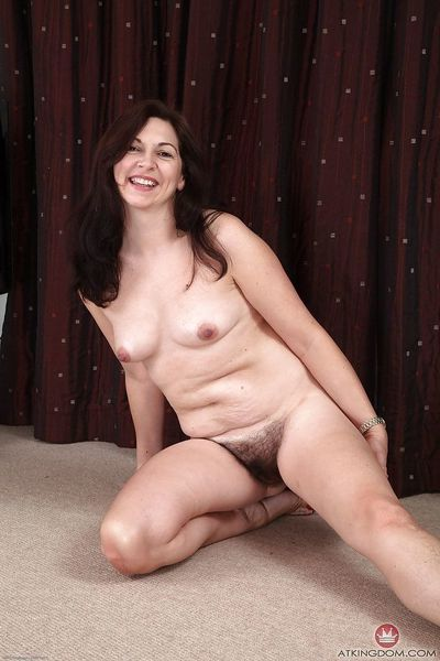 Experienced solo model Francesca revealing hairy underarms and bush