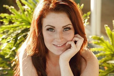 Teen redhead Emmy Sinclair standing in bikini outdoors for sfw scenes