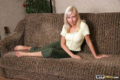 Fuckable golden-haired youthful erotic dancing and posing exposed on the daybed