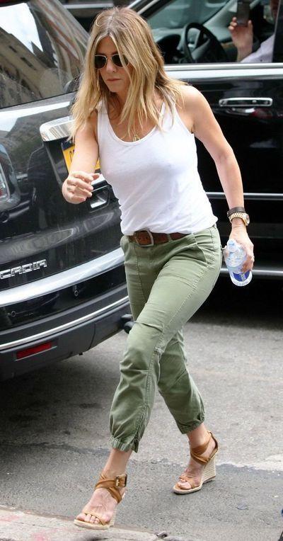 Jennifer aniston braless showing boob button pokies in public
