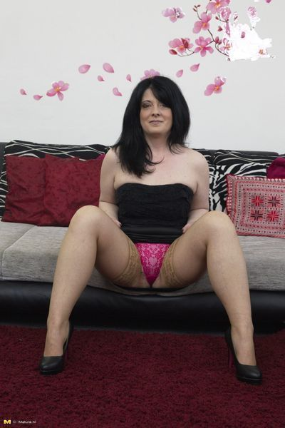 Bawdy housewife playing with her gear dude sub