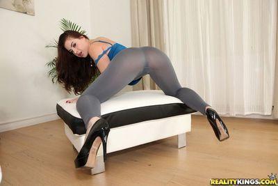 Juvenile gal Lexie Candy posing solo in skin rigid yoga shorts
