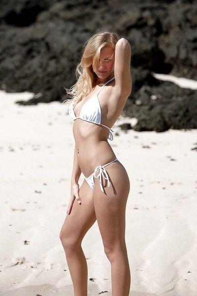 Hot babe pornstar takes off her bikini panties outdoor