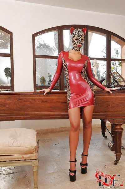 Hot fetish babe in latex outfit Black Angelica revealing her sweet pussy