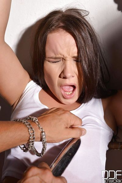 Young brunette Wendy Moon vaginally and anally penetrated while handcuffed