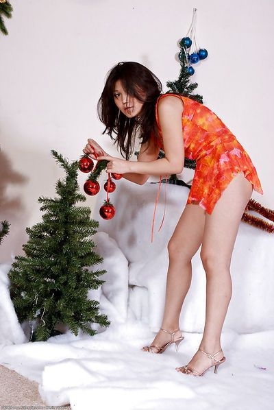 Close of pics of Japanese solo model Aksana pulling undies up cunt crack