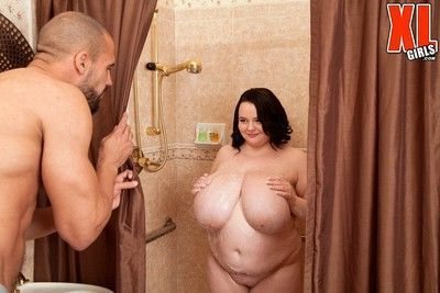 Chubby brunette fucked in shower by black cock