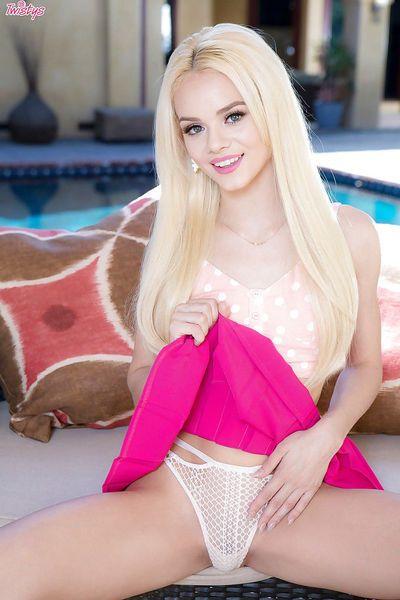 Tiny blonde pornstar Elsa Jean showing off bald pussy beside outdoor pool