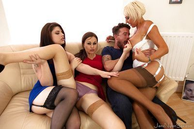 Blonde cougar Jan Burton having groupsex with two girls and a man