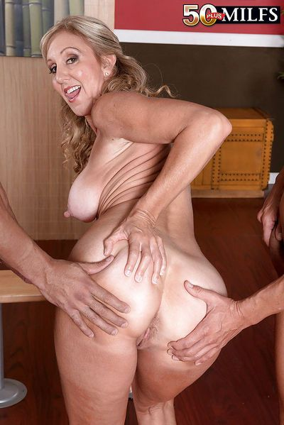 Older woman Jenna Covelli sucking and fucking 2 large cocks at same time