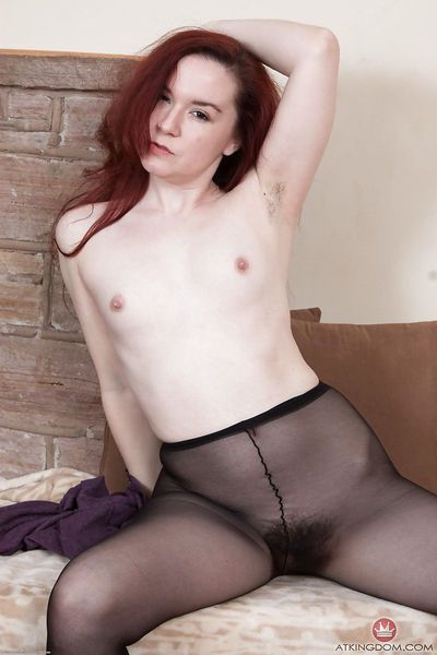 Hairy MILF Aunt Judy rolling pantyhose over legs before baring tiny tits