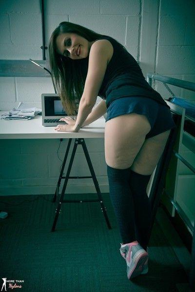 Beauty brunette strips to her black socks