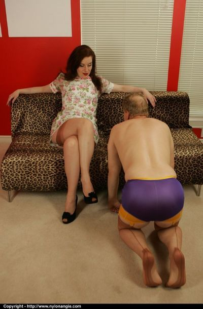 Seductive femdom in stockings face sitting and torturing a kinky guy