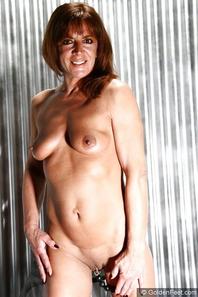 Older UK solo model Lady Sarah using sex toy on shaved cooter