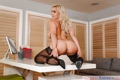 Platinum blonde pornstar Kylie Page freeing phat ass from underneath skirt