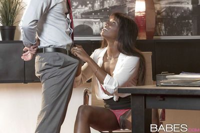 Ebony chick Ana Foxxx licking cum from large cock after BJ in office