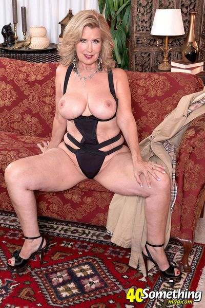 Classy mature woman Laura Layne doffs overcoat and lingerie to masturbate
