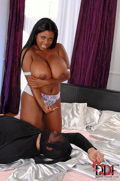 Thick black chick licks own nipples before taking tit fuck and cum on boobs