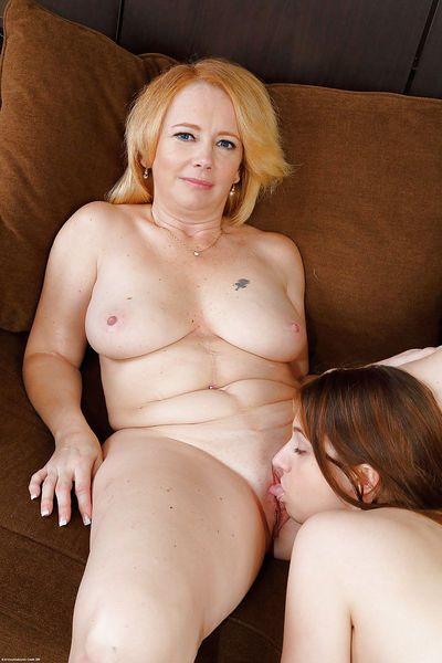 Older and younger lesbians Brandie Sweet and Elektra Rose fingering cunts
