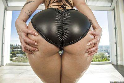 Tattoo model Dollie Darko flaunts her big fat booty outdoors