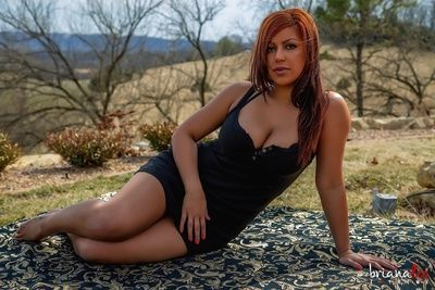 Hot redhead pornstar MILF Briana Lee toying pussy with dildo outdoors