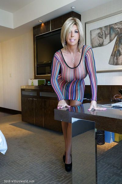 Older blonde housewife baring massive boobs during babe photo spread