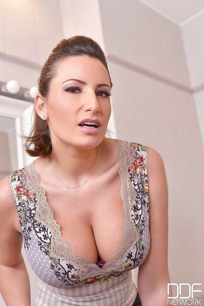 European solo girl Sensual Jane unveiling large MILF boobs in high heels