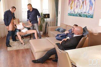 Busty blonde Chessie Kay taking blowbang from large cocks in gangbang