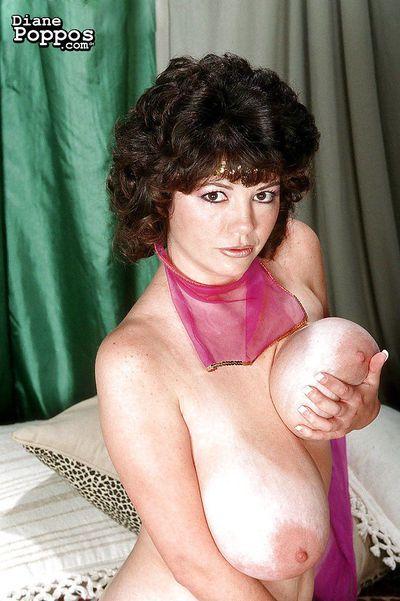 Mature Greek woman Diane Poppos letting big hanging tits fall free