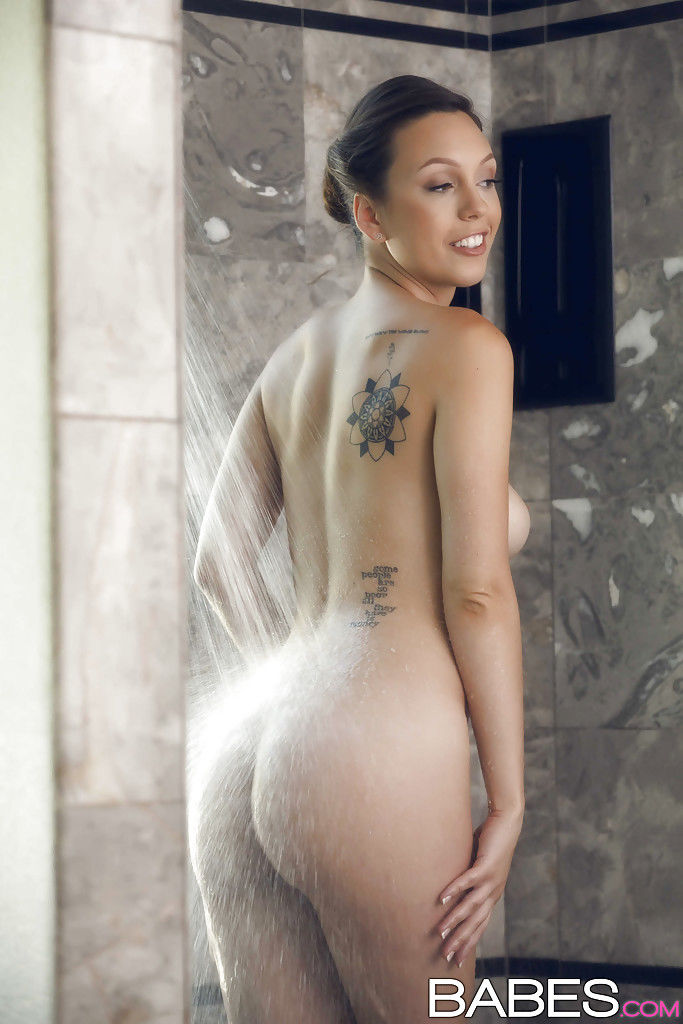 Tattooed solo model Jade Nile letting water run over nice tits in shower