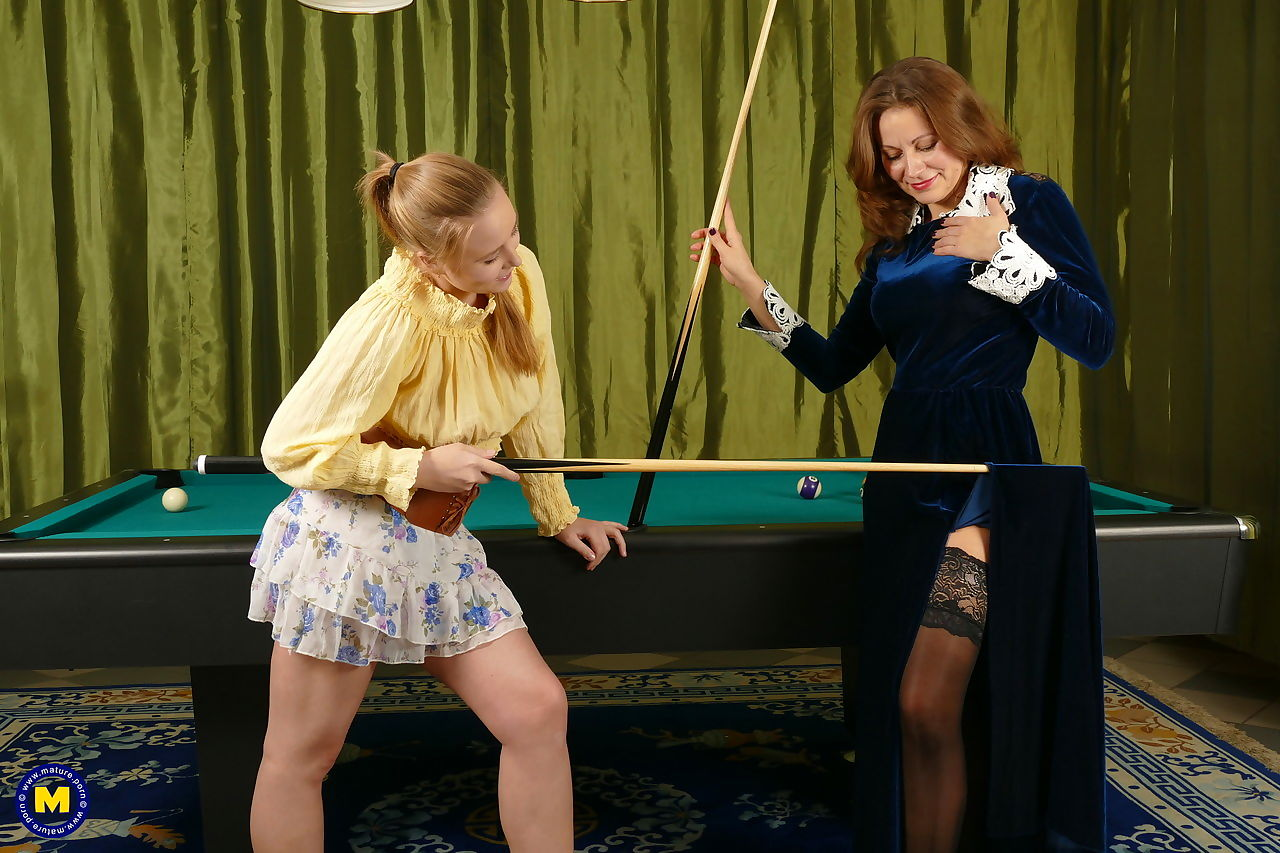 Mature lesbian seduces a young white girl over a game of pool
