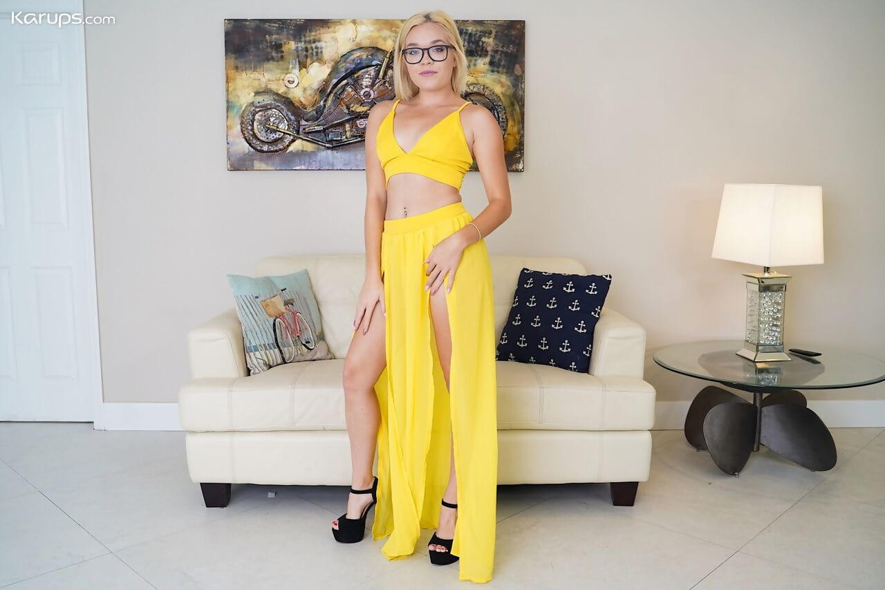 Nerdy blonde Katie Kush removes her outfit and thong to pose nude in heels