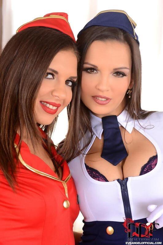 Dyke Euro pornstars Eve Angel & Henessy tribbing in stewardess uniforms