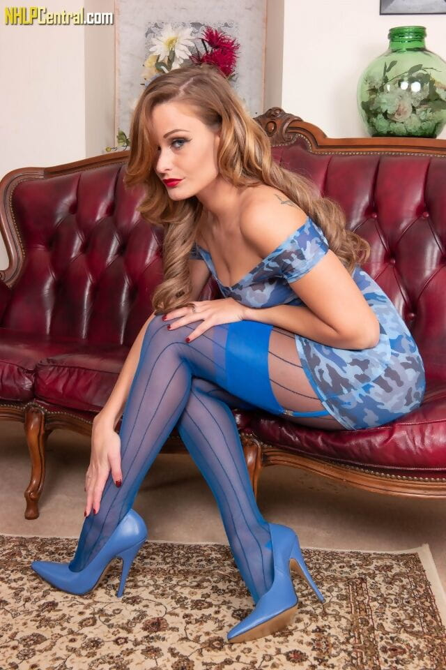 Solo model Honour May parts her pussy lips in crotchless pantyhose and heels