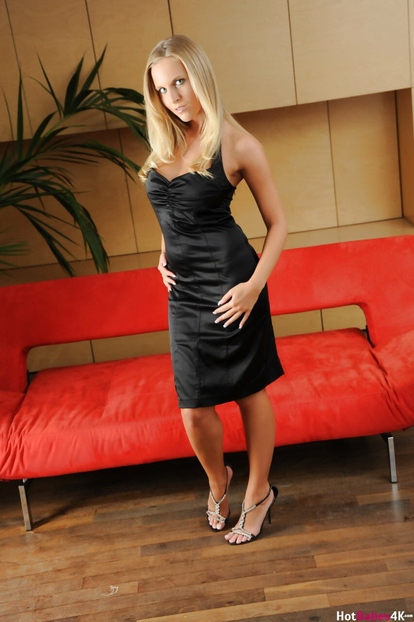 Czech MILF with blonde hair Cikita removes a black dress to pose nude in heels
