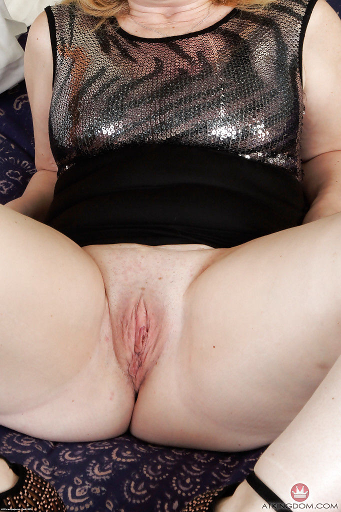 Older lady Brandie Sweet spreading for close ups of shaved pussy