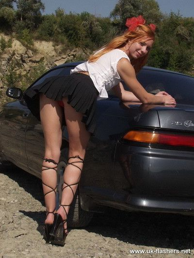 Cheeky exhibitionist poses on her boyfriends car at the beach