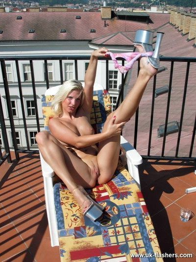 Amateur blonde exhibitionist sun bathing on the roof and toying