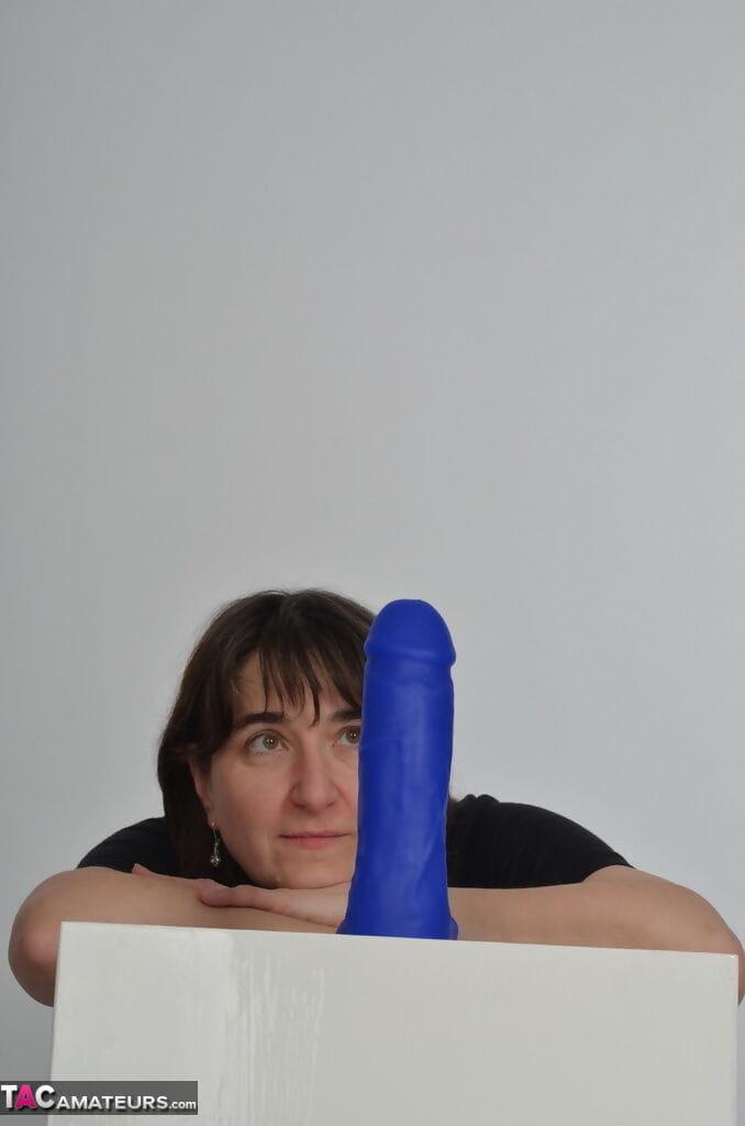 Amateur slut with saggy boobs riding a big blue dildo so damn good