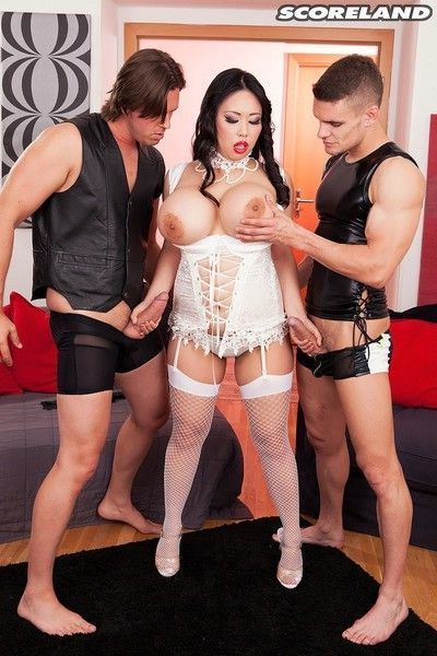 Busty asian mistress tigerr benson sucking two cocks