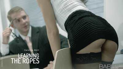 Clothed brunette Carolina Abril hiking micro skirt to fuck in office