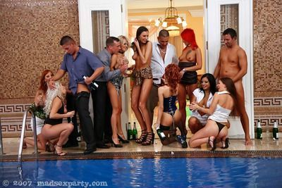 Lascivious girls have fun with horny guys at the pool party