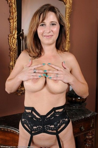 Busty curvy cougar spreads in stockings