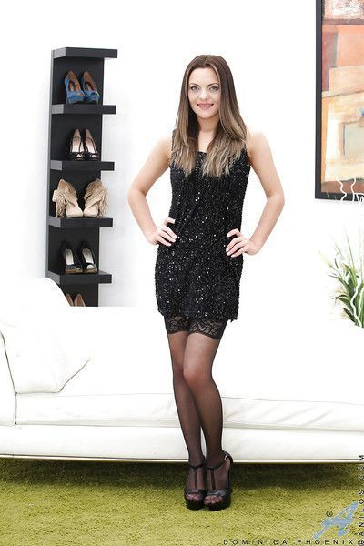 Clothed MILF Dominica Phoenix revealing smooth pussy in heels and stockings
