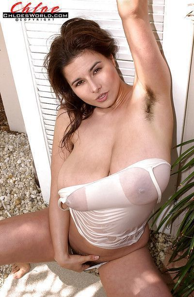 Brunette Euro chick Chloe Vevrier flaunting massive wet tits outdoors