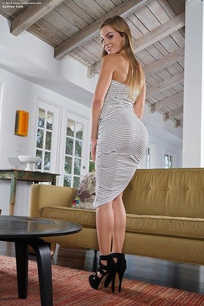 Hot blonde starlet Sydney strips out of her dress and masturbates
