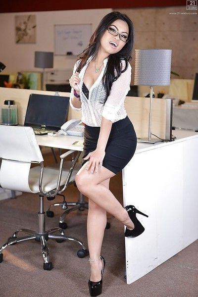 Asian secretary Cindy Starfall striking sexy poses in glasses and skirt
